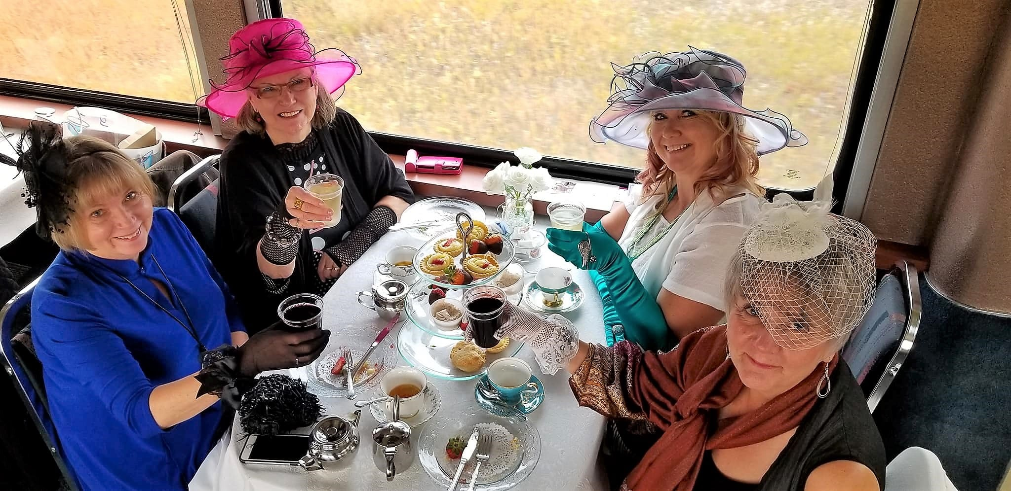 Ladies drinking tea during the high tea excursion
